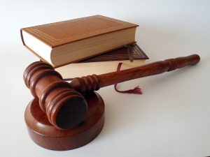Judge's gavel with law books